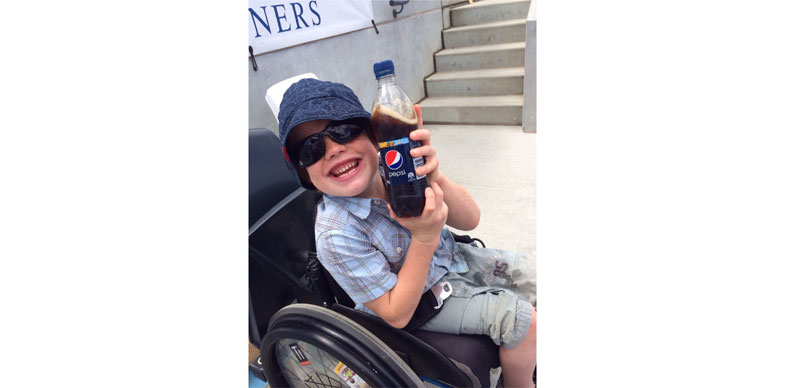 Sam in chair with Pepsi